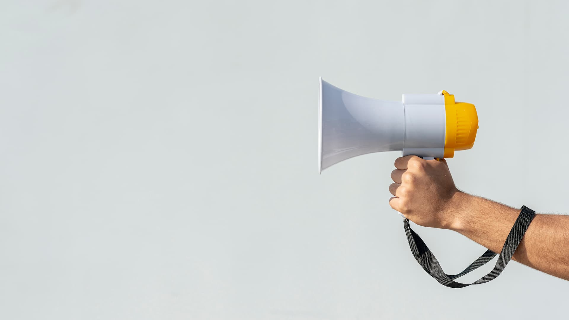 hand-holding-megaphone-for-protest-banner